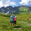 Stock Photo: Travelers in Alpine meadow. Melchsee-Frutt, Switzerland