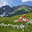 Girl in an Alpine meadow. Melchsee-Frutt, Switzerland — Stock Photo