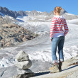 Traveler against Rhone glacier. Switzerland — Stock Photo