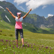 Girl on alpine meadow — Stock Photo