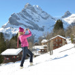 Girl with a camera in Swiss Alps  — Stockfoto