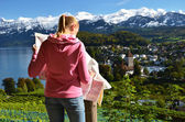 Girl looking to the map. Switzerland — Stock Photo