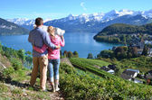 Travelers looking to the map. Switzerland — Stock Photo