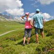 Stock Photo: Travelers on hill. Melchsee-Frutt, Switzerland