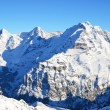 Eiger, Moench and Jungfrau, famous Swiss mountain peaks — Stock Photo #34368475