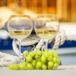 Wineglasses and grapes on the yacht pier of La Spezia, Italy — Stock Photo