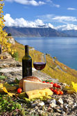 Red wine, chees, bread and cherry tomatos — Stock Photo