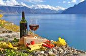 Red wine, chees, bread and cherry tomatos. Lavaux, Switzerland — Stock Photo