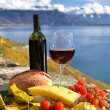 Red wine, cheese, bread and cherry tomatoes. Lavaux, Switzerland — Stock Photo