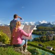 Stock Photo: Travelers looking to mountains. Switzerland