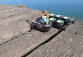 Chinese tea set on a wooden jetty — Stock Photo
