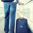 Traveler with suitcase on speedwalk — Stock Photo #36027661