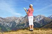 Traveler enjoying Alpine panorama. — Stock Photo