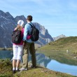 Travelers enjoying alpine view. — Stock Photo