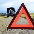 Triangle road sign and car — Stock Photo