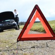 Broken car, girl and warning triangle — Stock Photo #42424959