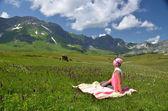 Girl in an Alpine meadow. — Stock Photo