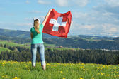 Girl with the Swiss flag. — Stock Photo