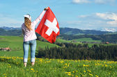 Girl with the Swiss flag. — Stok fotoğraf