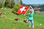 Girl holding the Swiss flag. — Stockfoto