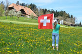 Girl with the Swiss flag. — Stockfoto