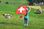 Girl holding the Swiss flag — Stock Photo