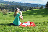 Woman with Jug of milk on the Swiss flag — Stock Photo