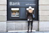 Girl at ATM — Stock Photo