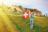 Girl holding Swiss flag — Stock fotografie