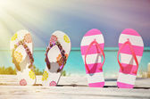 Two pairs of flip-flops against Atlantic — Stock Photo