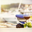 Pair of wineglasses and grapes against the yacht pier — Stock Photo #48953277