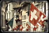 Old street in Zurich decorated with flags — Zdjęcie stockowe
