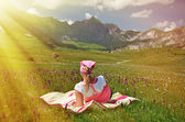 Girl in an Alpine meadow. — Stock Photo