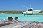 Sunglasses on  wooden jetty — Stock Photo