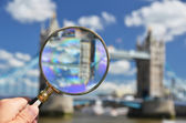 Magnifying glass against Tower bridge — Stock Photo