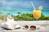 Orange juice and sunglasses — Stock Photo
