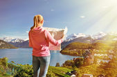 Girl looking to the map in Spiez — Stock Photo