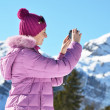 Girl takes pictures of mountains — Stock Photo #51598157