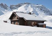 Farm house buried under snow — Stock Photo