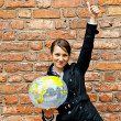 Woman by the wall with world map — Stock Photo #12756693