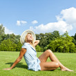 Beautiful young woman with hat in park with big sexy smile doing — Stock Photo
