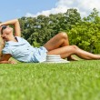 Stock Photo: Beautiful young womin park with big joyfull smile on green me
