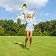 Beautiful young woman jump up to the sky in park in blue dress — Stok fotoğraf