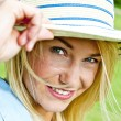 beautiful young woman with hat in park with big joyfull smile do — Stock Photo