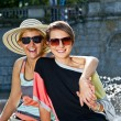 Travel two woman and sideseeing foutain with big smile - Stock Photo