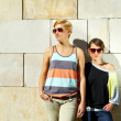 Two  beautiful woman with sunglasses on natural background — Stok fotoğraf