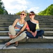 Two  beautiful woman with sunglasses on the stairs - Stockfoto