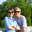 Two  beautiful woman with sunglasses on natural background — Zdjęcie stockowe