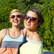 Two  beautiful woman with sunglasses on natural background - ストック写真