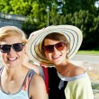 Travel two woman and sideseeing foutain with big smile - Stockfoto